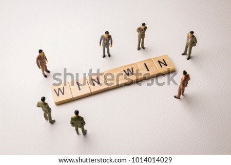 Miniature figures businessman : meeting on win win letters by wooden block word on white paper background, in concept of business and corporation #1014014029