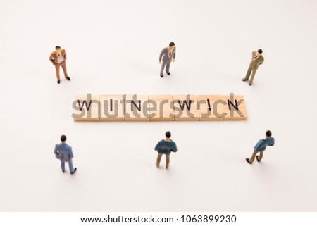 Miniature figures businessman : meeting on win win word by wooden block word on white paper background, in concept of business and corporation #1063899230