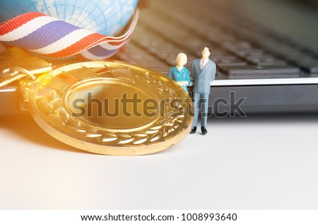 Miniature figurine with Medals Awards for winner of competition, Honor students studying or testing exams in leading universities, school, Competitions and Education study concepts #1008993640