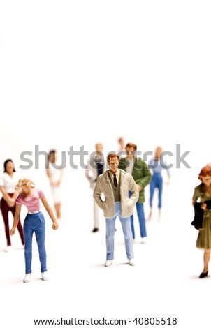 miniature figurines of people of various age and gender on white background