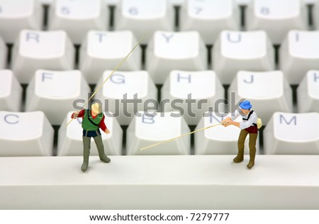 Miniature fisherman representing online email phishing scams. Online phishing and identity theft concept.