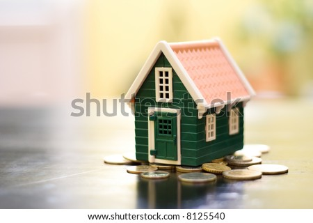 Miniature green house on coins base