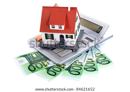 Miniature house with money and counter, new home concept