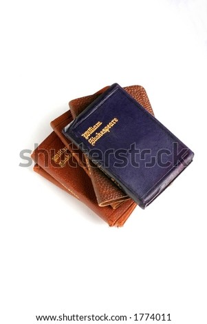 Miniature leather books of shakespearean plays.