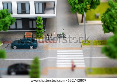 Miniature model, miniature toy buildings, cars and people. City maquette. Photo stock ©