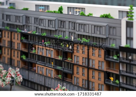 Miniature model, miniature toy buildings, cars and people. City maquette. New building project Photo stock ©