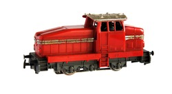 Miniature Model of red railroad locomotive isolated on a white background