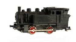 Miniature Model of Steam Engine isolated on a white background