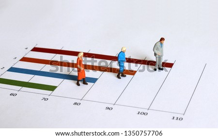 Miniature old people walking on the graph. The concept of an aging society.