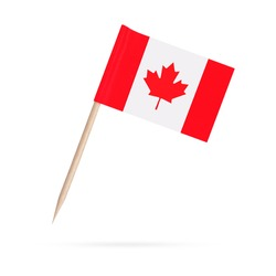 Miniature paper flag Canada. Isolated Canadian toothpick flag pointer on white background. With shadow below
