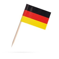 Miniature paper flag Germany. Isolated German flag on white background. With shadow below
