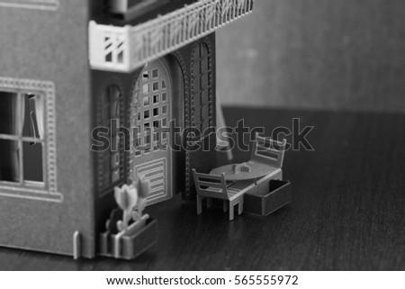 Miniature paper house put on dark background scene. #565555972