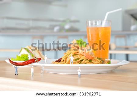 Miniature people are serving food