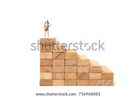 Miniature people: Backpacker standing on wood block isolated on white background, Travel concept #756968083