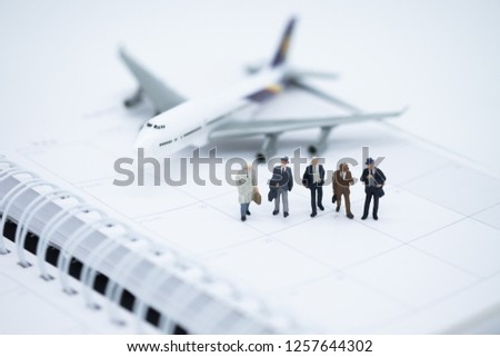 Miniature people : Business man walking on calendar book with the plane. Picture user for success, dealing, partner, greeting planning and business competition winner concept.