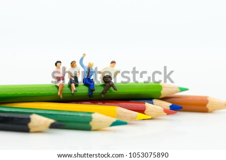 Photo of Miniature people: Businessman sitting on the color pencil. Image use for background education,or business concept.