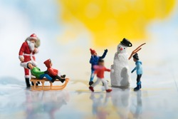 Miniature people: Colorful Christmas characters and decorations. Using as background or wallpaper holiday concept.