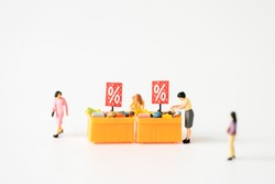 Miniature people Family Father Mother and children go shopping buying supplies supermarket mart grocery things using for internet online marketing Credit Card spending money department store business