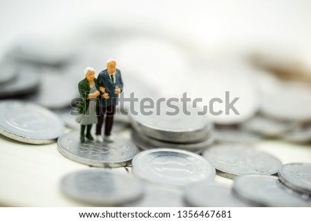Miniature people: Happy old people standing on coins stack, Retirement planning, Emergency plan, Life insurance and Financial Concept. Сток-фото ©