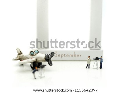 Miniature people : journalists , cameraman ,Videographer at work shooting of airplane with toy building using for concept Patriot Day #1155642397