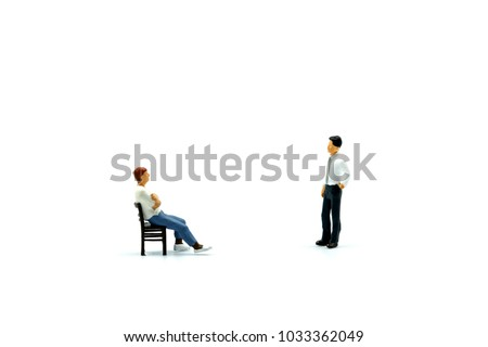 Miniature people : Man sitting a chair with businessman.