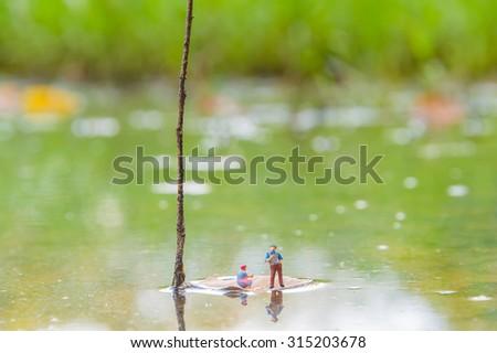 Miniature people on leaf  #315203678