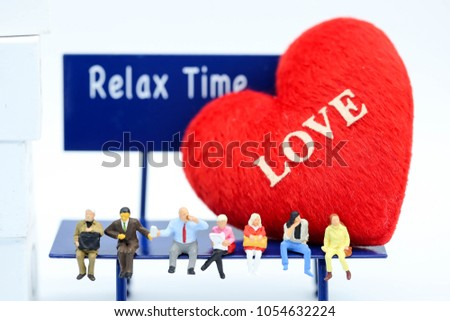 Miniature people : people sitting on chair and doll heart of love,relax time concept. #1054632224