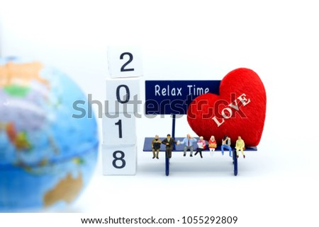 Miniature people : people sitting on chair and doll heart of love,relax time concept. #1055292809