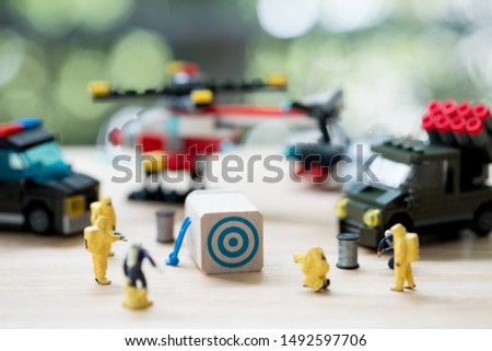 Miniature people : Police and detective are working. crime scene investigation. Cyber crimes concept