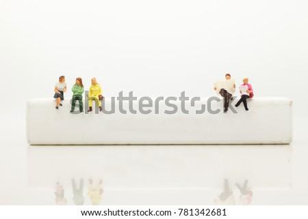 miniature people  sitting on...