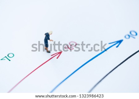Miniature people: Small old women figures standing on age mile arrow. An aging society and pension concepts.  #1323986423