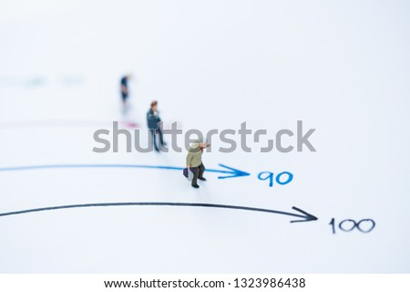 Miniature people: Small old women figures standing on age mile arrow. An aging society and pension concepts.  #1323986438