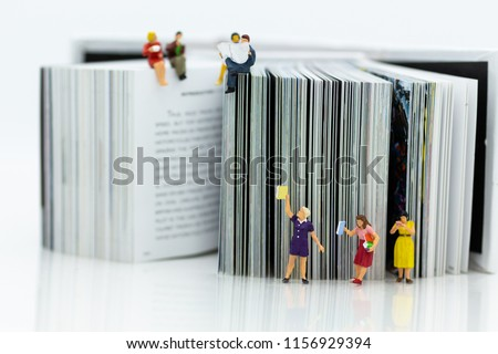 Photo of Miniature people: Students read books, keep books on bookshelves . Image use for education concept.