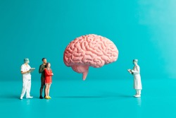 Miniature people Surgeon spoke with patient about brain injuries. World Stroke Day concept.