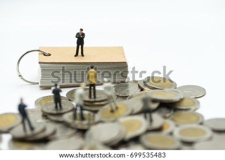Miniature people: the recruiter standing on top of notebook for finding the candidates on the coins stack, recruitment process, HR, HRM, HRD concepts.