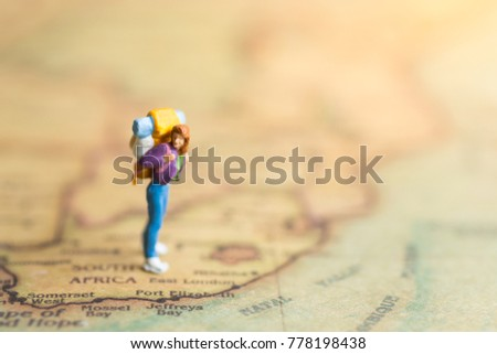 Miniature people : traveler walking on the map. Used to travel to destinations on travel business background concept. #778198438