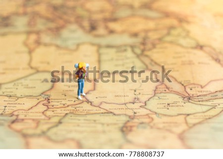 Miniature people : traveler walking on the map. Used to travel to destinations on travel business background concept. #778808737
