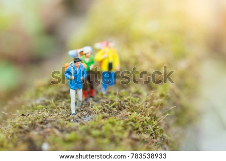 Miniature people : traveler walking on the roads are cluttered with grass. Used to travel to destinations on travel business background concept. #783538933
