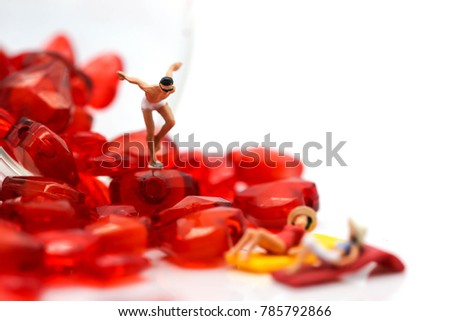 miniature people : wearing swimsuit relaxing with red heart,lover concept #785792866