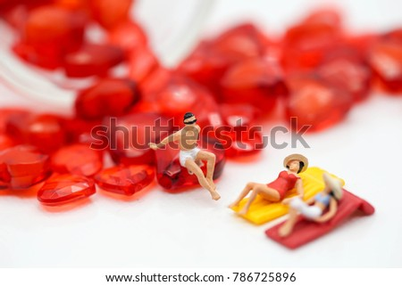 miniature people : wearing swimsuit relaxing with red heart,lover concept #786725896