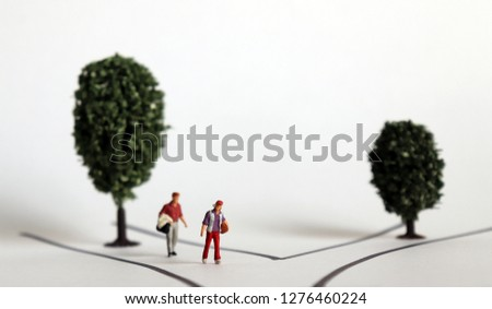 Miniature people with two roads and two trees. The concept of a new challenge. #1276460224