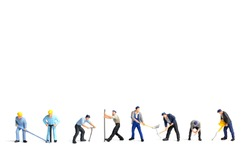 Miniature people worker holding tool on white background,construction concept