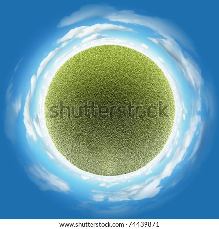 Miniature planet with clear thick grass lawn vegetation and clouds on blue sky