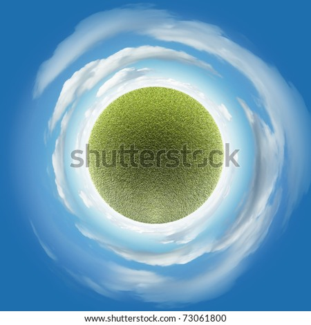 Miniature planet with grass vegetation and atmosphere with clouds