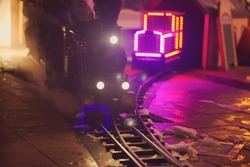 Miniature Steam Locomotive Attraction at Night Front View