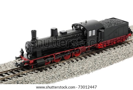 Miniature steam locomotive isolated over white background