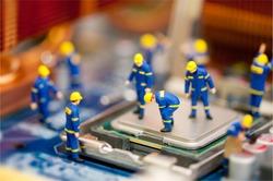 Miniature technician repairing computer