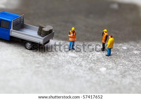 Miniature technicians working