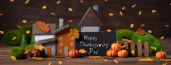 Miniature Thanksgiving Day little fairy autumn cottages, pumpkins, copyspace, wooden background, postcard concept, toned