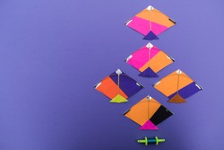 Miniature tiny kites with small spool of thread rolls, Patang with firki manjha for this uttarayan makar sankranti specil indian festival of kite flying. colorful kites to wish happy sankrant new year